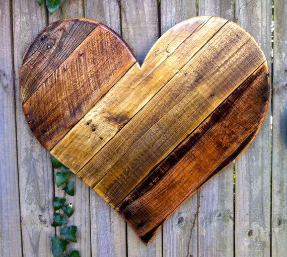 Colourful rustic heart hanging with rough wood
